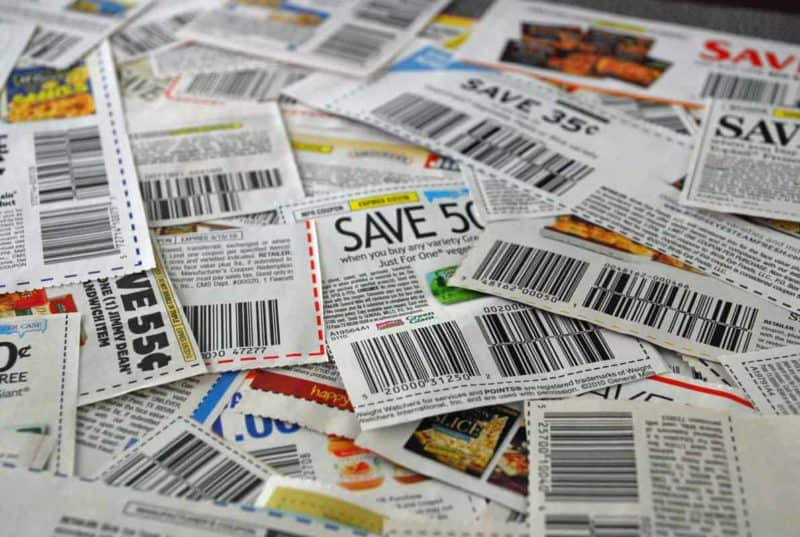 pile of clipped manufacturer coupons