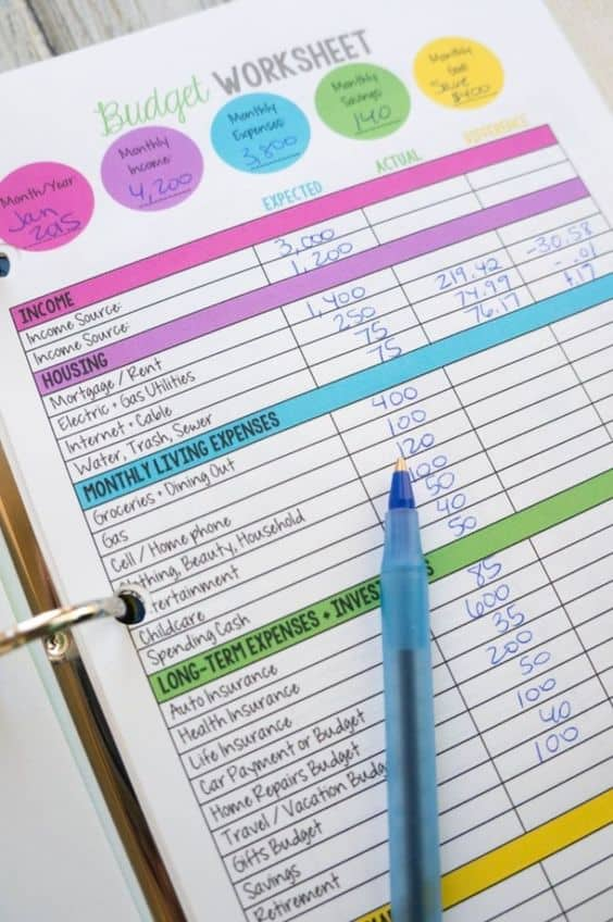 Colorful printable monthly budget template in a binder