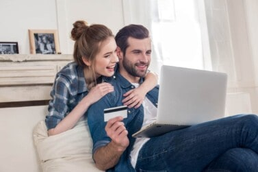 Couple celebrating their credit score after they were able to quickly repair and increase it with CreditRepair.com
