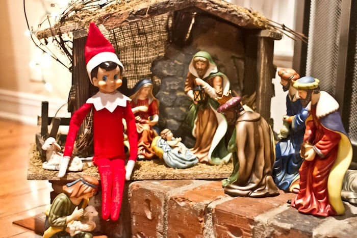 elf sitting in a nativity scene for elf on a shelf idea
