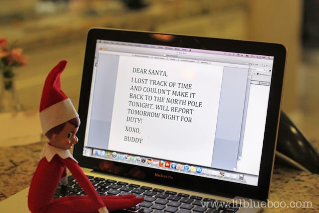 elf sitting on laptop writing letter to his boss Santa