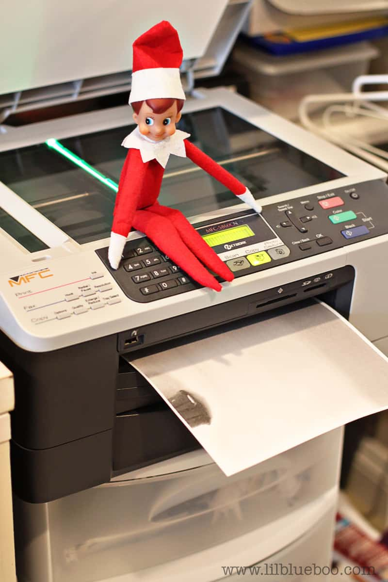elf sitting on copier making copy of butt for elf on the shelf idea for work