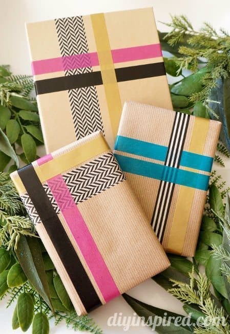 brown paper wrapped gifts with custom washi tape designs gift wrapping idea