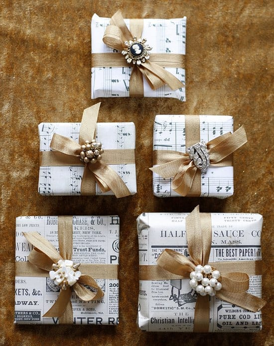 gifts wrapped in repurposed sheet music unique gift wrapping idea