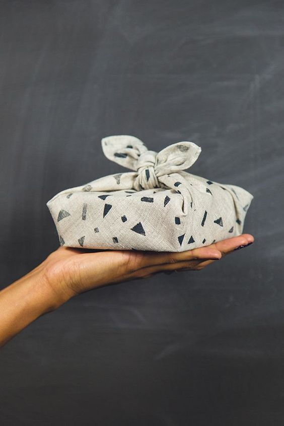 simple fabric tied around a gift unique gift wrapping idea