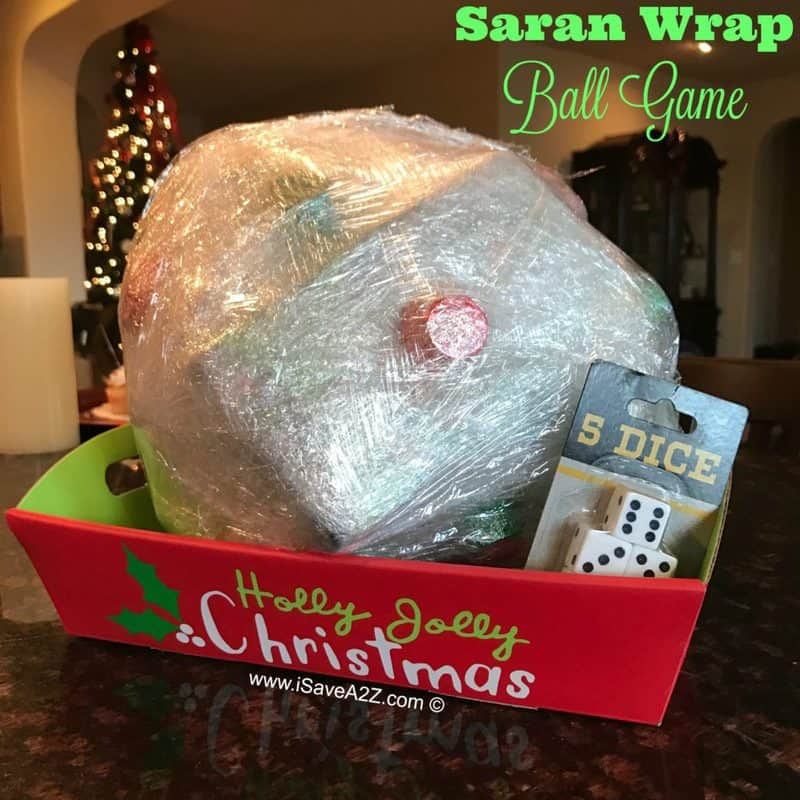 large ball of saran wrap in a tray, containing smaller gifts inside for a fun and playful gift wrapping idea