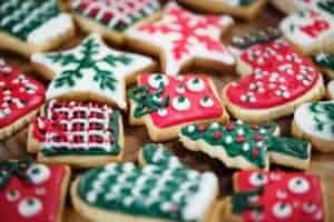 iced Christmas cookies on wood cutting board