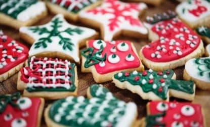 iced Christmas cookies on wood cutting board