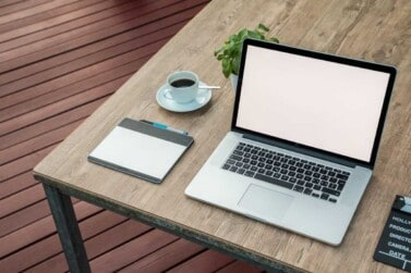 laptop with coffee on wood table