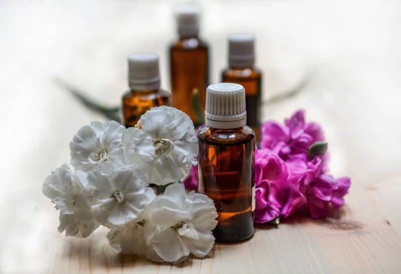 essential oils bottles with gray and purple flowers