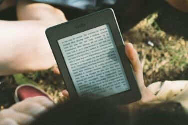 person reading an amazon kindle e-reader