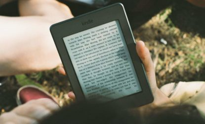 person reading an amazon kindle e-reader