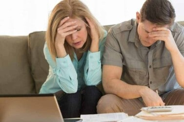 couple worrying over their budget as they try to pay off debt