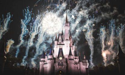 fireworks at night over the cinderella castle at disneyworld