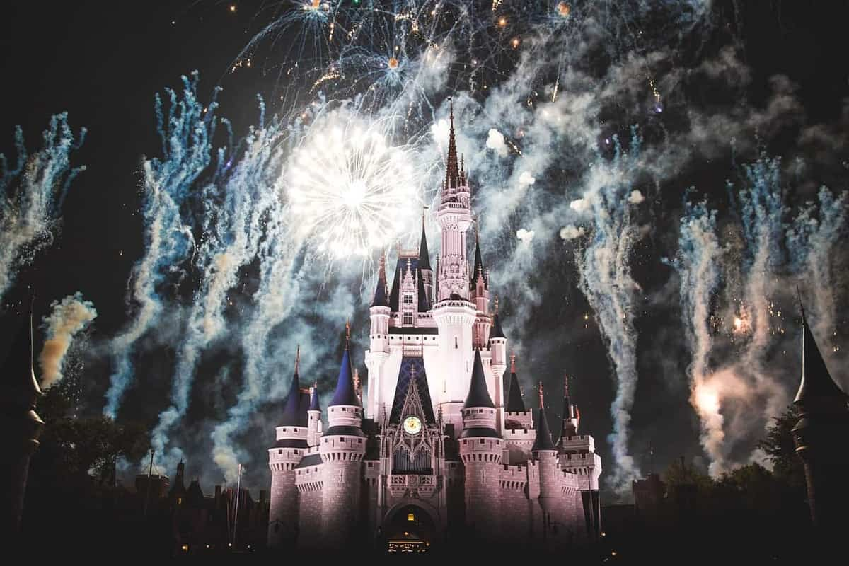 fireworks at night over the cinderella castle at disneyworld