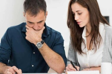 young couple looking at their financial plan