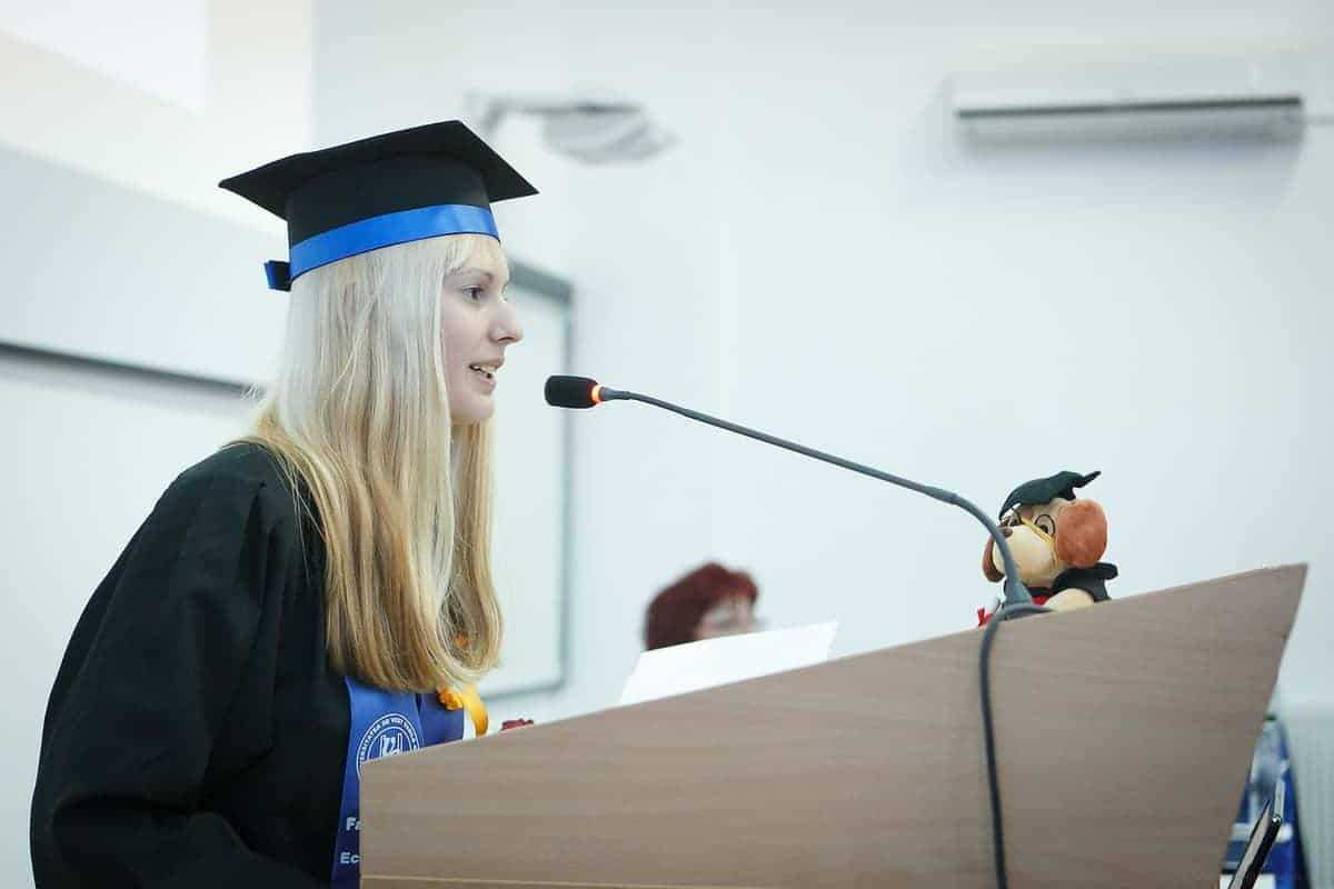 Female college student at the podium giving a speech.