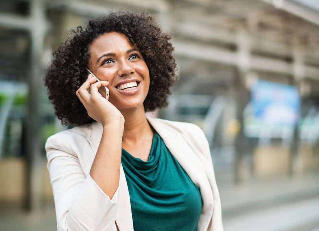 woman on making a phone call to dispute credit report information fix your credit score hacks