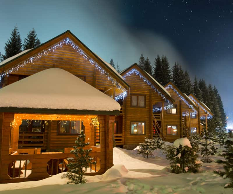 Beautiful ski chalets at night rented on airbnb