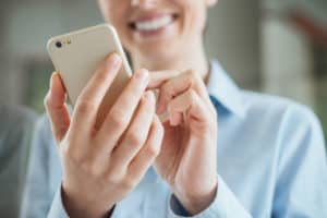 happy woman saving money through her phone by using trim
