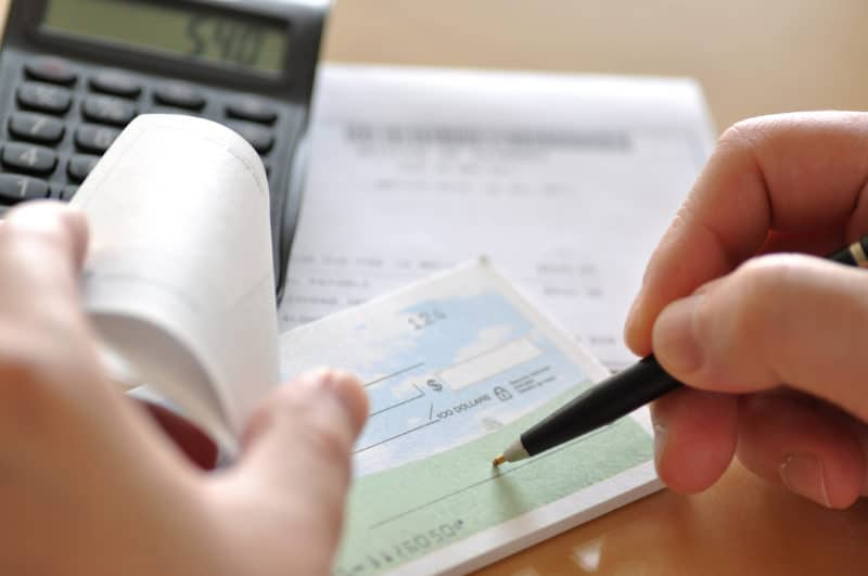 Prepare writing a check to pay bill on time