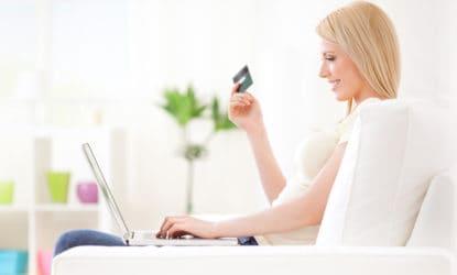 Beautiful young woman shopping online.