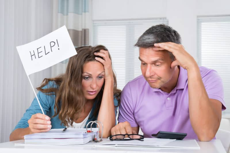 stressed couple facing budgeting challenge not sure how much to spend
