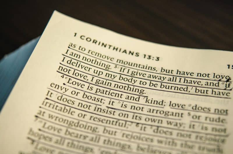 close up image of bible page showing a portion of 1 corinthians 13:3 biblical marriage quote