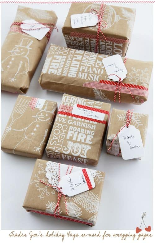 holiday printed store paper bags repurposed to become holiday wrapping paper easy frugal gift wrapping ideas