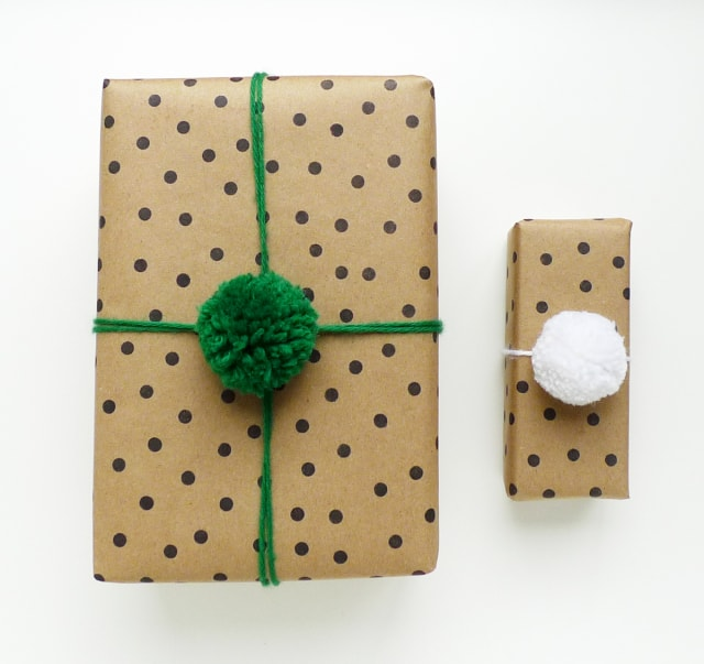 polka dot paper with yarn pom poms easy gift wrapping idea