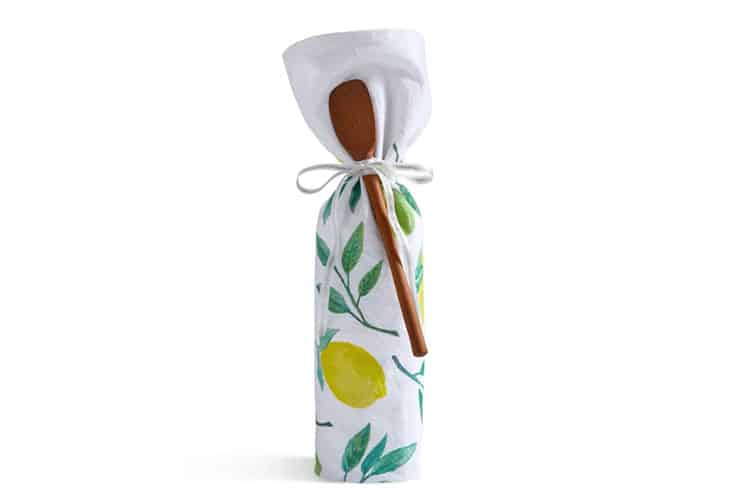 tea towel and wooden spoon used as a unique gift wrapping idea