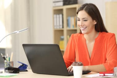 Beautiful freelancer working with a laptop in a desk at home room or office