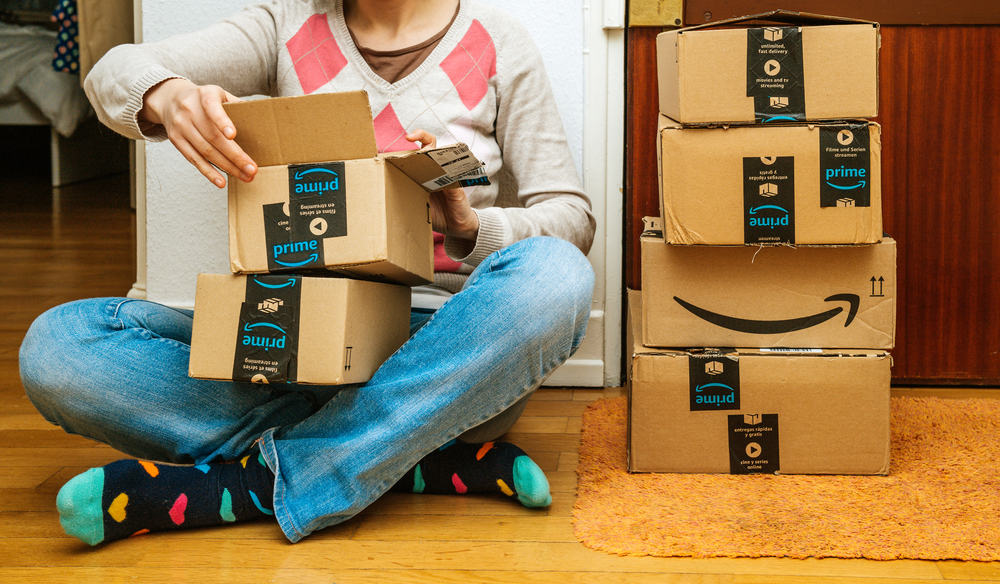 Woman smiling unboxing Amazon cardboard