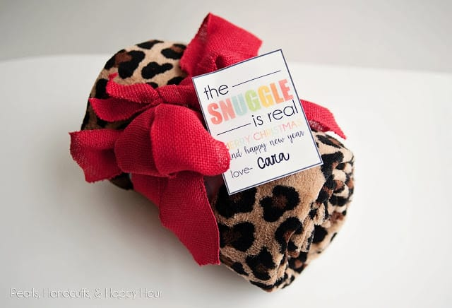 blanket wrapped in a bow with gift tag