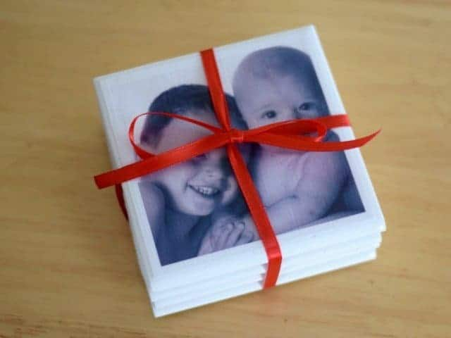 cheap christmas gifts / coasters with photos wrapped in a ribbon