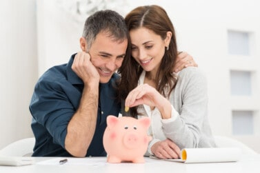 couple putting money into savings after earning with passive income ideas