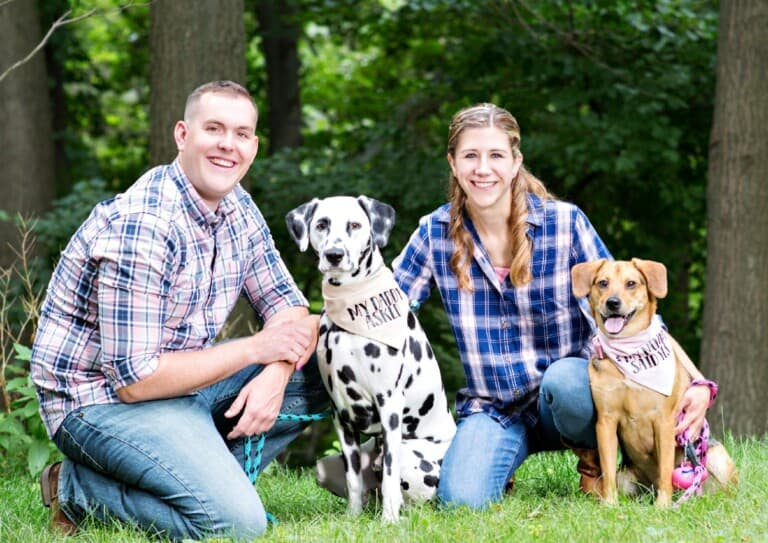 couple posing with dogs from their rover dog sitting side hustle