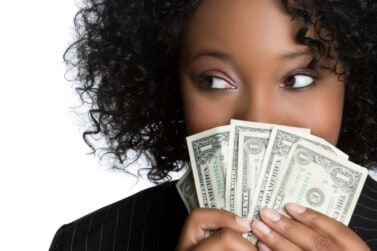 woman holding money wondering what amazon work from home jobs pay