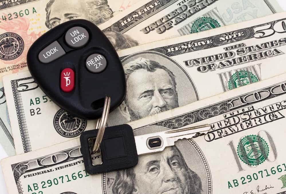 A set of car keys with cash, car payment