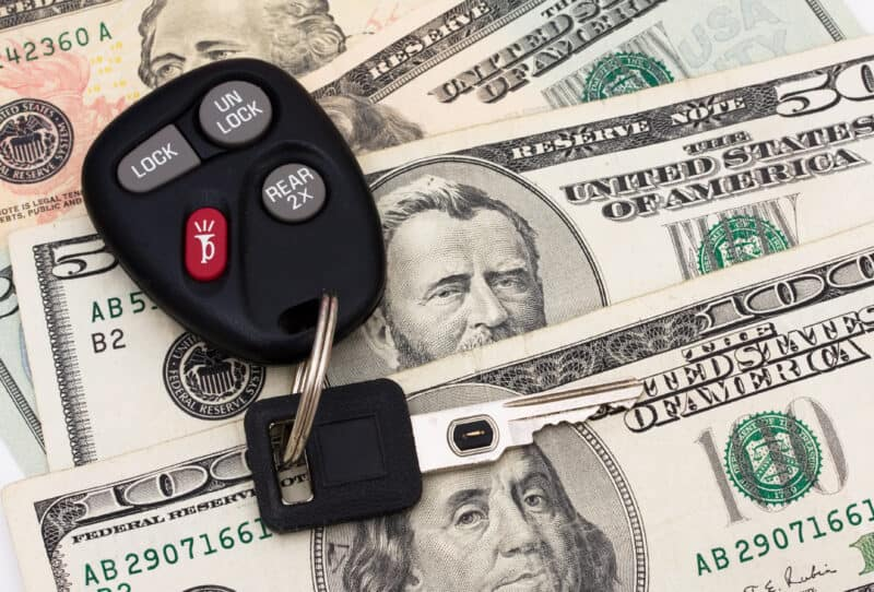 cash and car keys strike a deal to make a profit flipping cars