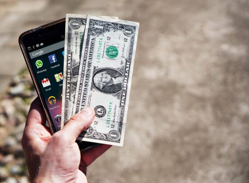 phone and money to show free stocks and earning money with investing apps