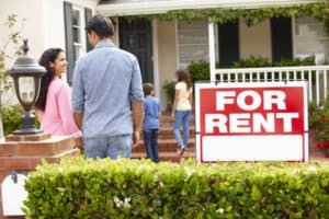Roofstock Review Hispanic family outside home for rent