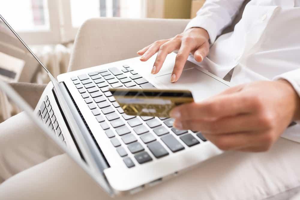 self credit card reviewFemale laptop finger table desk indoor