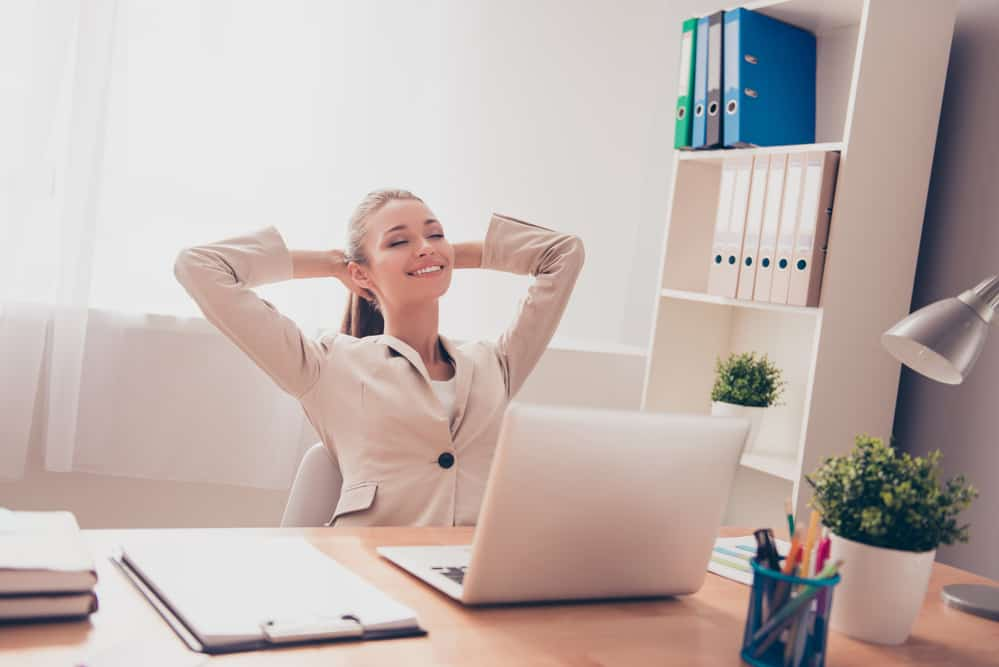 jobs where you work alone Portrait of happy smiling businesswoman having break and resting